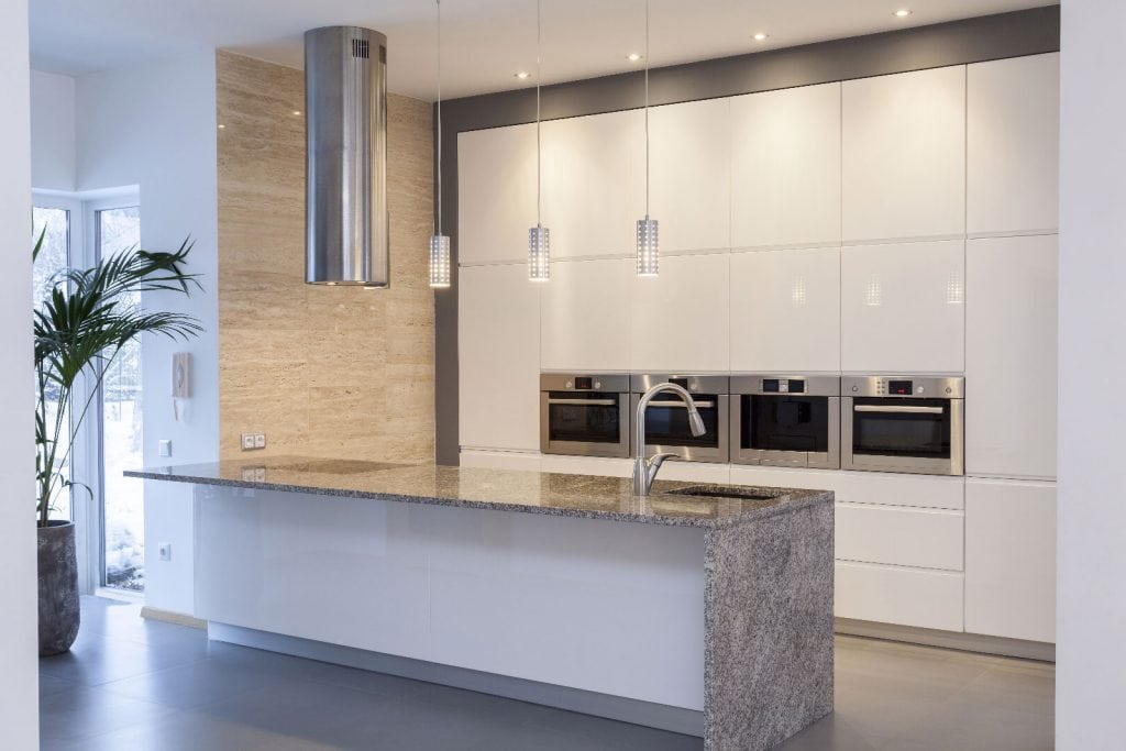 Travertine adds a a sense of warmth and welcome to this kitchen