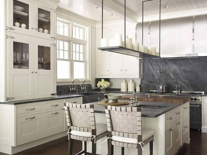 Ivory Kitchen Cabinets With Soapstone Countertop And Soapstone Slab Backsplash, Primestones® Granite, Quartz, Marble